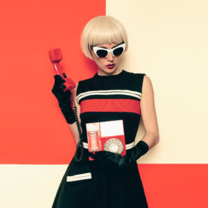 Blond retro style with vintage phone and vintage clothing. Minimal Fashion